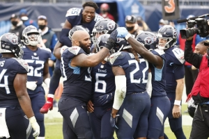 Tennessee Titans running back Derrick Henry (22) is mobbed by teammates after Henry scored the winning touchdown against the Houston Texans in overtime of an NFL football game Sunday, Oct. 18, 2020, in Nashville, Tenn. The Titans won 42-36.