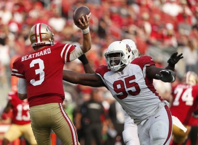 In this Oct. 7, 2018, file photo, Arizona Cardinals defensive tackle Rodney Gunter (95) pressures San Francisco 49ers quarterback C.J. Beathard (3) during the second half of an NFL football game in Santa Clara, Calif. Gunter, who signed as a free agent in March with the Jacksonville Jaguars, is stepping away from football because of an enlarged aorta. Gunter, who had been placed on the team's non-football injury list at the start of training camp, dropped the news in a statement Sunday, Aug. 16, 2020