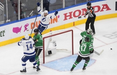 Tampa Bay Lightning center Steven Stamkos, top left, celebrates his goal against Dallas Stars goaltender Anton Khudobin (35) during the first period of Game 3 of the NHL hockey Stanley Cup Final, Wednesday, Sept. 23, 2020, in Edmonton, Alberta.