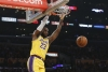 LeBron sets triple-double mark, Lakers hold off OKC