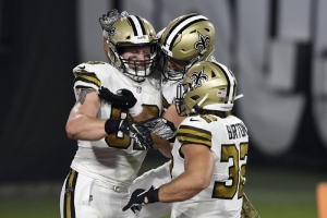 New Orleans Saints tight end Josh Hill (89) celebrates with teammates, including running back Michael Burton (32), after catching a 3-yard touchdown pass from quarterback Drew Brees during the second half of an NFL football game against the New Orleans Saints Sunday, Nov. 8, 2020, in Tampa, Fla.