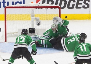 Dallas Stars goalie Anton Khudobin (35) makes a save against the Vegas Golden Knights as Stars defenseman Jamie Oleksiak (2) slides into the crease during second-period NHL Western Conference final playoff game action in Edmonton, Alberta, Saturday, Sept. 12, 2020.