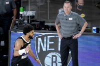 Denver Nuggets' Jamal Murray, left, reacts near head coach Michael Malone after a play against the Utah Jazz during the second half of an NBA basketball first round playoff game, Monday, Aug. 17, 2020, in Lake Buena Vista, Fla.