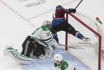 Colorado Avalanche's Tyson Jost (17) crashes into Dallas Stars' goalie Anton Khudobin (35) during the first period of an NHL hockey Stanley Cup playoff game in Edmonton, Alberta, Friday, Sept. 4, 2020.