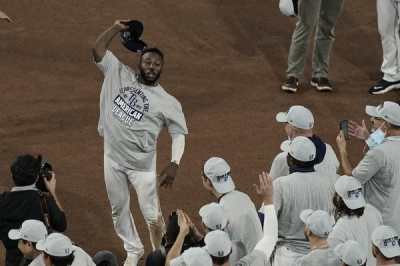Tampa Bay Rays left fielder Randy Arozarena celebrates his MVP award following their victory against the Houston Astros in Game 7 of a baseball American League Championship Series, Saturday, Oct. 17, 2020, in San Diego. The Rays defeated the Astros 4-2 to win the series 4-3 games