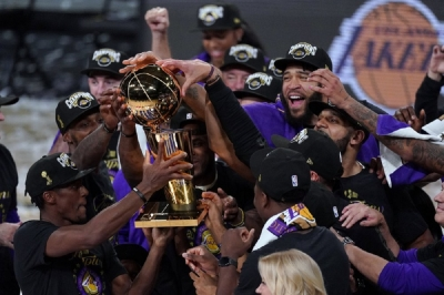 The Los Angeles Lakers players celebrate after the Lakers defeated the Miami Heat 106-93 in Game 6 of basketball's NBA Finals Sunday, Oct. 11, 2020, in Lake Buena Vista, Fla.