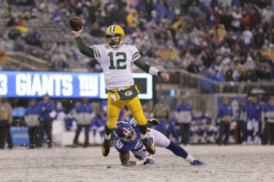 Rodgers throws 4 TDs, Packers beat skidding Giants
