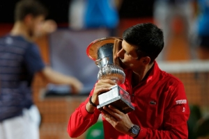 Italian Open - Foro Italico, Rome, Italy - September 21, 2020 Serbia's Novak Djokovic kisses the trophy after winning the final against Argentina's Diego Schwartzman.