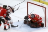 Crawford lead Blackhawks to 1st win, over Oilers