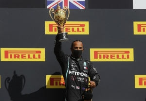 Hamilton limps to record British GP win after late puncture
