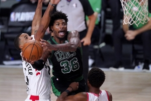 Boston Celtics' Marcus Smart (36) goes up for a shot against Toronto Raptors' Norman Powell, left, and Kyle Lowry during the second half of an NBA conference semifinal playoff basketball game Friday, Sept. 11, 2020, in Lake Buena Vista, Fla.
