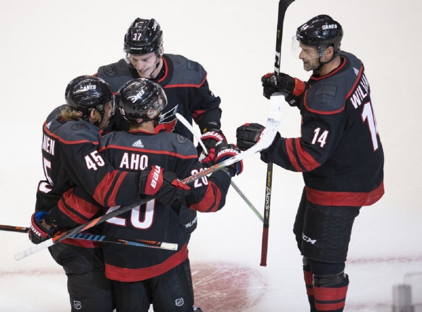 Aho leads Hurricanes to win over Rangers in NHL's return