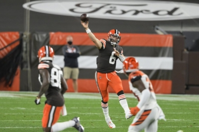 Cleveland Browns quarterback Baker Mayfield throws a pass during the first half of an NFL football game against the Cincinnati Bengals, Thursday, Sept. 17, 2020, in Cleveland.