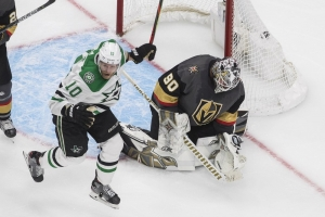 Dallas Stars' Corey Perry (10) reacts as the puck goes in past Vegas Golden Knights goalie Robin Lehner (90) on a goal by Denis Gurianov during overtime NHL Western Conference final playoff game action in Edmonton, Alberta, Monday, Sept. 14, 2020