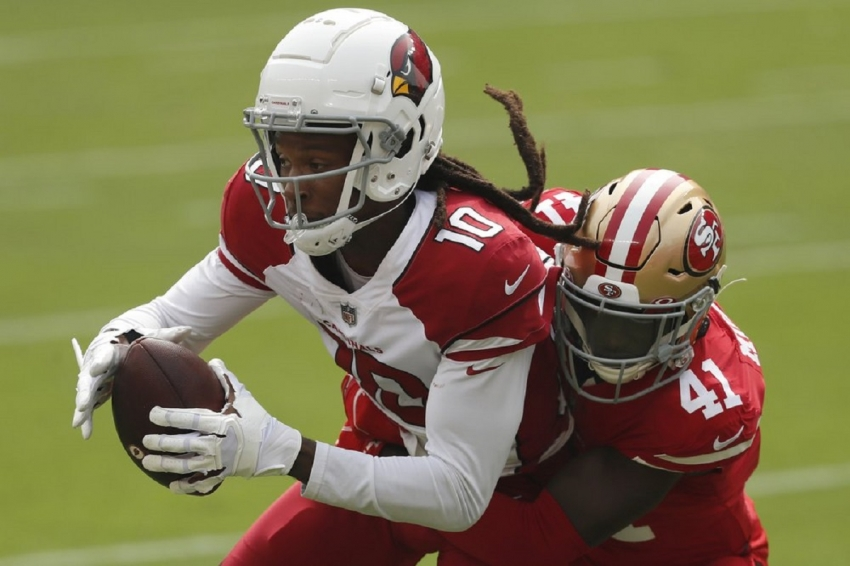 Arizona Cardinals wide receiver DeAndre Hopkins (10) catches a pass against San Francisco 49ers cornerback Emmanuel Moseley (41) during the first half of an NFL football game in Santa Clara, Calif., Sunday, Sept. 13, 2020.