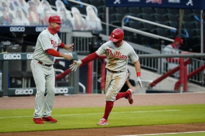 Philadelphia Phillies' J.T. Realmuto (10) celebrates after he hits a solo home run during the third inning of a baseball game against the Sunday, Aug. 23, 2020, in Atlanta.