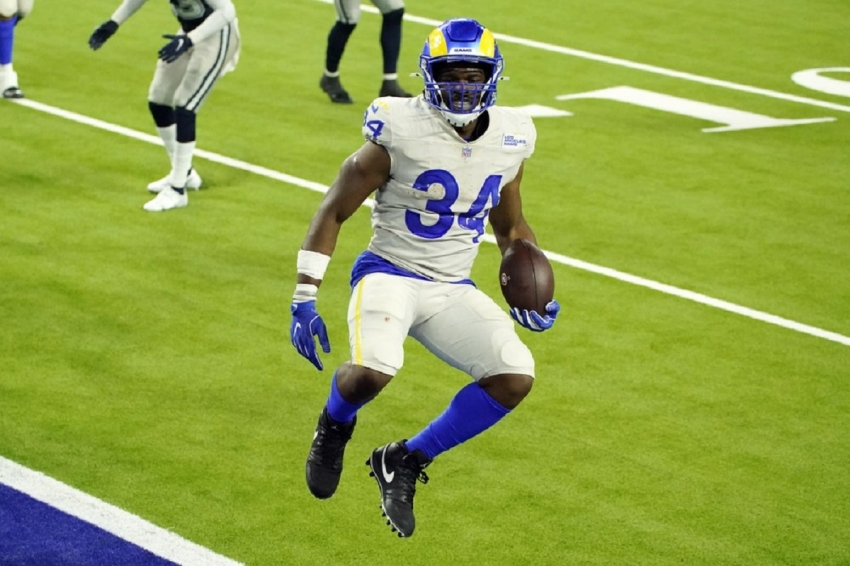 Los Angeles Rams running back Malcolm Brown leaps into the end zone for a touchdown during the second half of an NFL football game against the Dallas Cowboys Sunday, Sept. 13, 2020, in Inglewood, Calif.