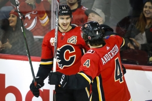 Hanifin has goal, 2 assists, Flames rally past Devils
