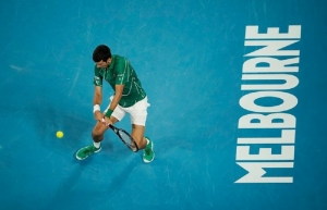 Djokovic downs Federer in straight sets to reach final