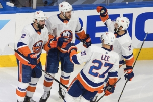 New York Islanders defenseman Ryan Pulock (6) celebrates his goal against the Tampa Bay Lightning with teammates during the first period of Game 5 of the NHL hockey Eastern Conference final, Tuesday, Sept. 15, 2020, in Edmonton, Alberta.