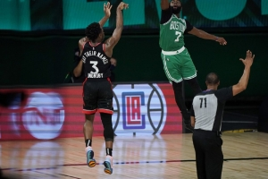 Toronto Raptors' OG Anunoby (3) releases a game-winning shot at the buzzer over Boston Celtics' Jaylen Brown (7) in the second half of an NBA conference semifinal playoff basketball game Thursday, Sept 3, 2020, in Lake Buena Vista Fla.