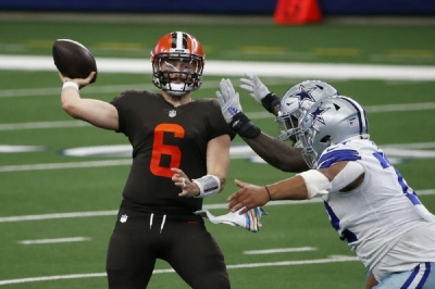 Cleveland Browns quarterback Baker Mayfield (6) throws a pass under pressure from the Dallas Cowboys defense in the first half of an NFL football game in Arlington, Texas, Sunday, Oct. 4, 2020.