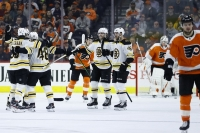 Bruins snap Flyers' 9-game win streak behind Rask shutout