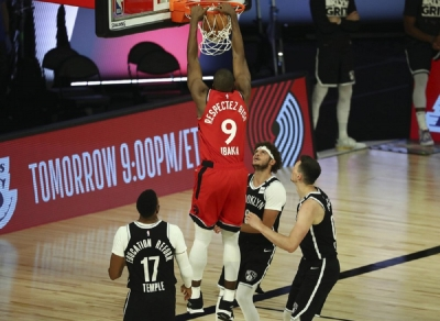 Toronto Raptors center Serge Ibaka (9) dunks to score a basket against the Brooklyn Nets during the second half of Game 4 of an NBA basketball first-round playoff series, Sunday, Aug. 23, 2020, in Lake Buena Vista, Fla.