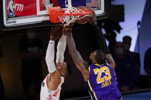 Los Angeles Lakers' LeBron James (23) blocks a shot by Houston Rockets' Russell Westbrook (0) during the second half of an NBA conference semifinal playoff basketball game Friday, Sept. 4, 2020, in Lake Buena Vista, Fla.
