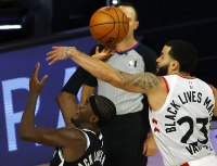 Fred VanVleet (23) of the Toronto Raptors blocks a shot attempt from Caris LeVert of the Brooklyn Nets during the fourth quarter of Game 2 of an NBA basketball first-round playoff series, Wednesday, Aug. 19, 2020, in Lake Buena Vista, Fla.