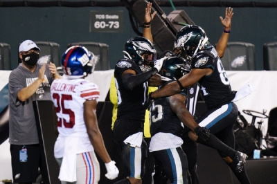 Philadelphia Eagles players celebrate after a touchdown by Boston Scott during the second half of an NFL football game against the New York Giants, Thursday, Oct. 22, 2020, in Philadelphia