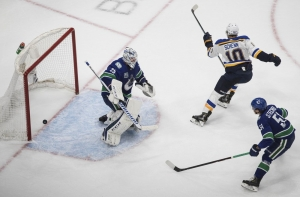 Vancouver Canucks goalie Jacob Markstrom (25) gives up a goal to St. Louis Blues' Brayden Schenn (10) as Troy Stecher (51) defends during overtime in Game 3 of an NHL hockey first-round playoff series, Sunday, Aug. 16, 2020, in Edmonton, Alberta.