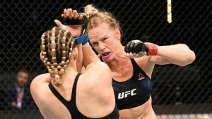 Holm puts it 'all together,' easily outpoints Aldana
