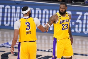 Los Angeles Lakers' Anthony Davis (3) and LeBron James (23) shake hands in the final moments of their 114-108 win over the Denver Nuggets in an NBA conference final playoff basketball game Thursday, Sept. 24, 2020, in Lake Buena Vista, Fla