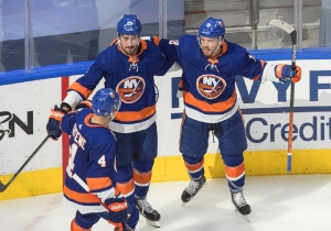 New York Islanders' Andy Greene (4), Brock Nelson (29) and Anthony Beauvillier (18) celebrate a goal on the Tampa Bay Lightning during the second period of Game 3 of the NHL hockey Eastern Conference final, Friday, Sept. 11, 2020, in Edmonton, Alberta.