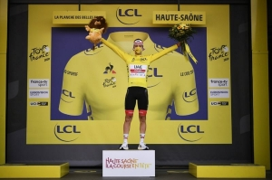 Tour de France - Stage 20 - Lure to La Planche des Belles Filles - France - September 19, 2020. UAE Team Emirates rider Tadej Pogacar of Slovenia, wearing the overall leader's yellow jersey, celebrates on the podium.
