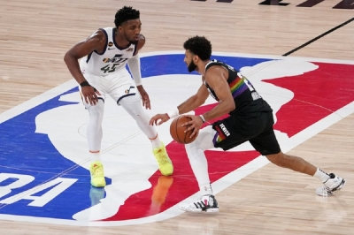 Utah Jazz's Donovan Mitchell (45) defends as Denver Nuggets' Jamal Murray (27) advances the ball down court during the second half an NBA first round playoff basketball game, Tuesday, Sept. 1,2020, in Lake Buena Vista, Fla.
