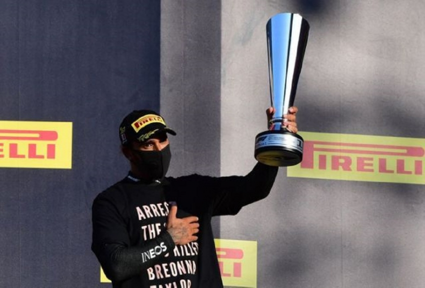 Formula One F1 - Tuscan Grand Prix - Mugello, Scarperia e San Piero, Italy - September 13, 2020 Mercedes' Lewis Hamilton celebrates with the trophy on the podium after winning the race