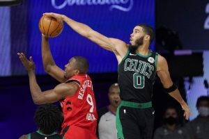 Boston Celtics' Jayson Tatum (0) blocks the shot of Toronto Raptors' Serge Ibaka (9) during the second half of an NBA conference semifinal playoff basketball game Monday, Sept. 7, 2020, in Lake Buena Vista, Fla