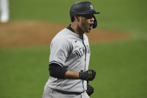 New York Yankees' Gary Sanchez reacts after hitting a two-run home run off Cleveland Indians relief pitcher Triston McKenzie durng the sixth inning of Game 2 of an American League wild-card baseball series, Wednesday, Sept. 30, 2020, in Cleveland.